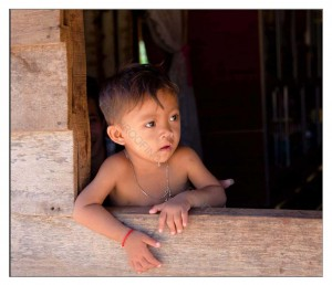 Khmer child in a window
