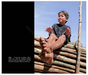 Young boy on stakes - these stakes was used for making fishing traps
