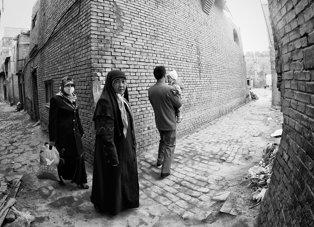 A Uyghur family preparing for an outing.