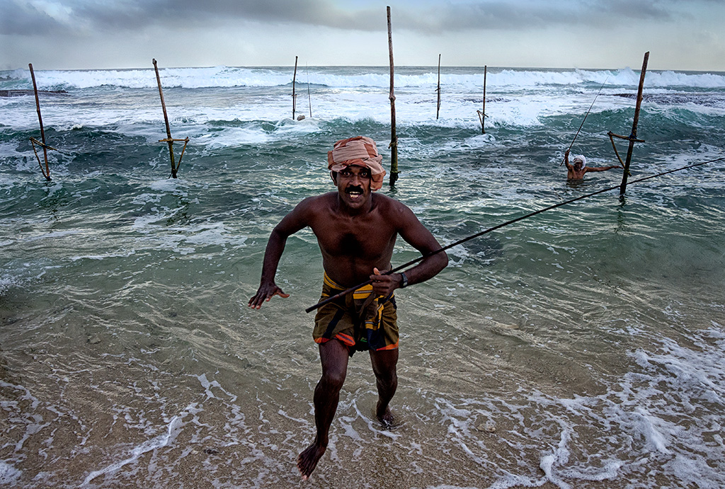One of the fishermen coming onto the shore