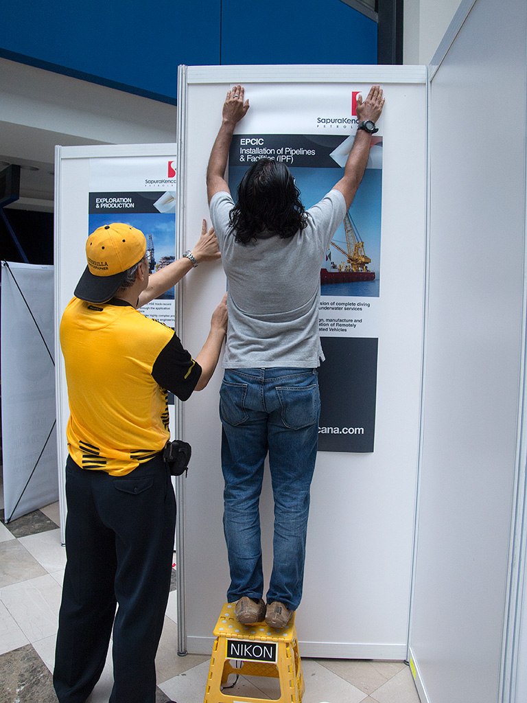 Putting up the posters for our Sponsor