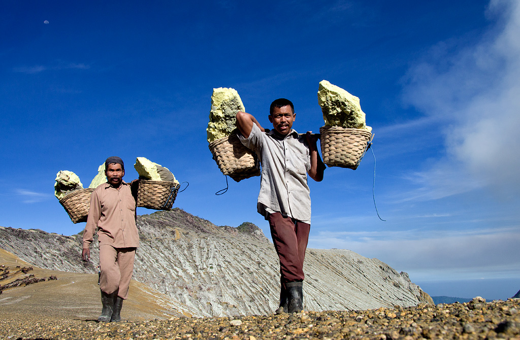 Life is hard for sulphur miners at Ijen caldera. They carry about 100kg slabs of sulphur on their shoulders from the mine to the factory that takes more than four hours for a round trip