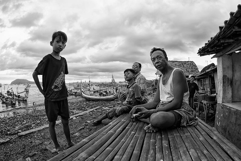 Kampong Muncar residents relaxing after a hard day's work