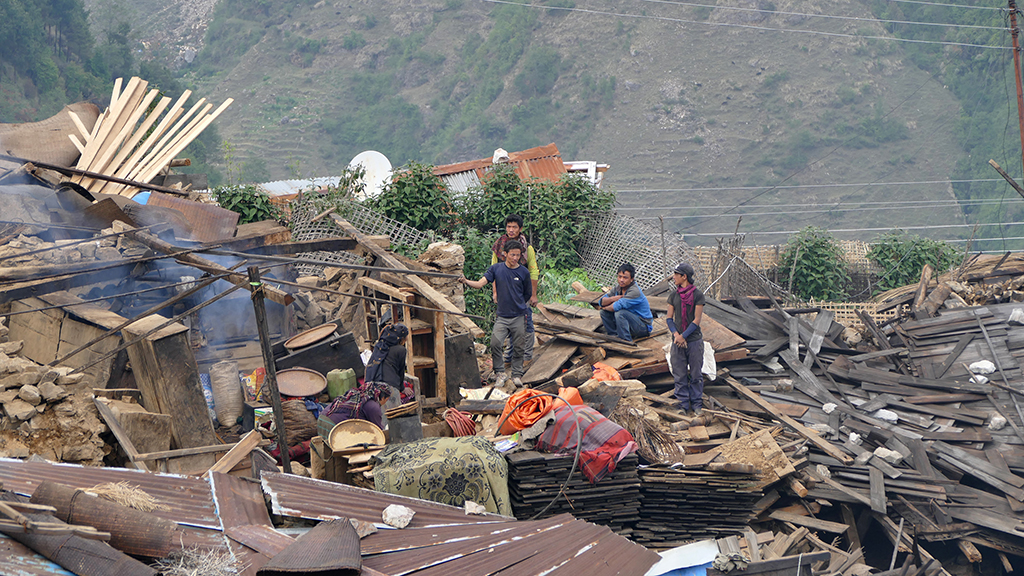 Residents combing through the rubble.