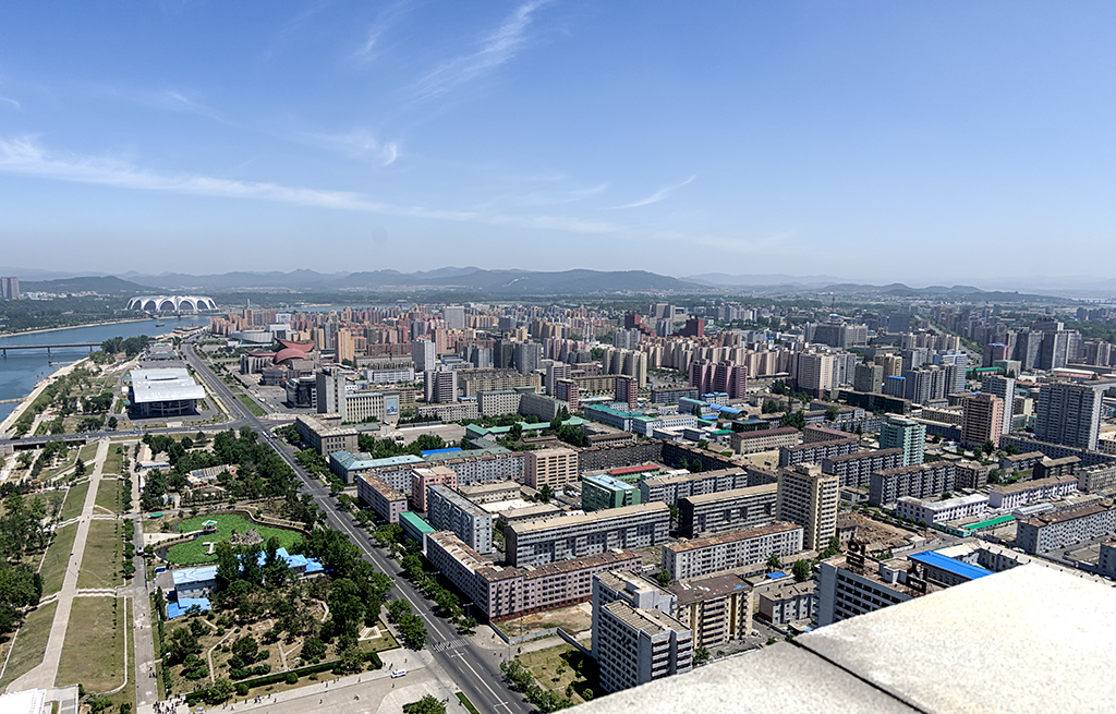 Pyongyang is a modern city with many highrise buildings. This view was taken at Juche Tower. The height of the view deck is 150m and the total height including the spire is 170m.