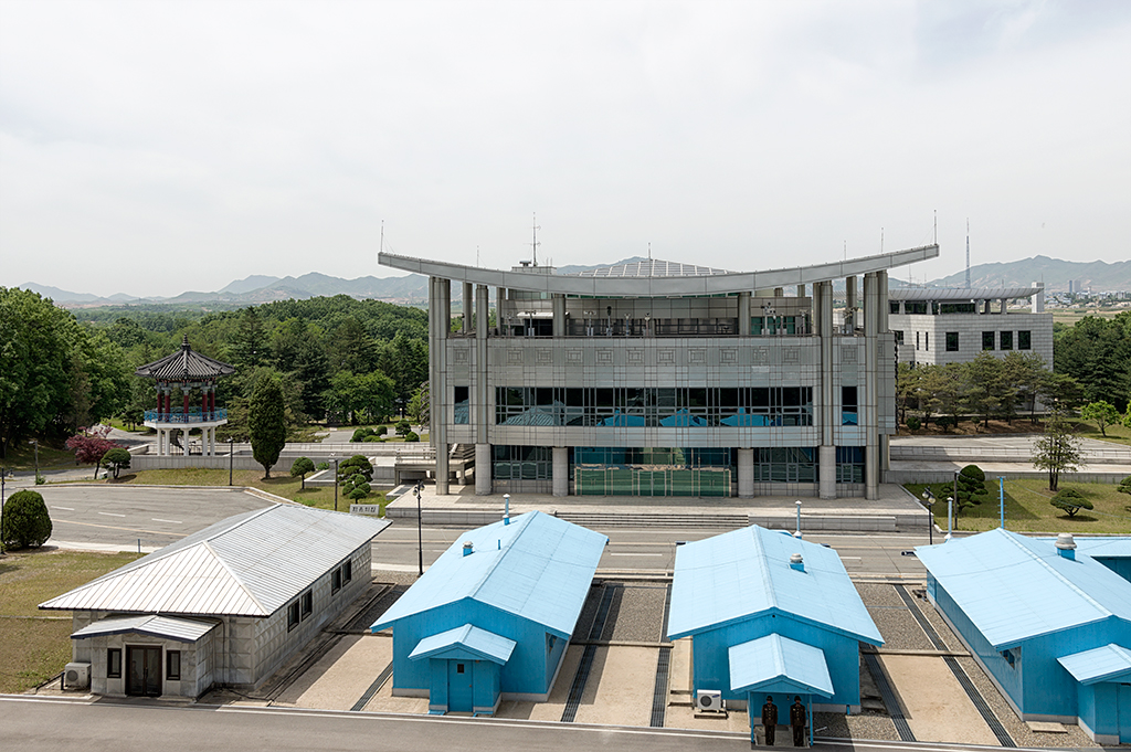 Command post on the South Korean side. Beyond that is South Korea. The small curb on the mid way of the single storey stores is the official dividing boundary between DPRK and South Korea.