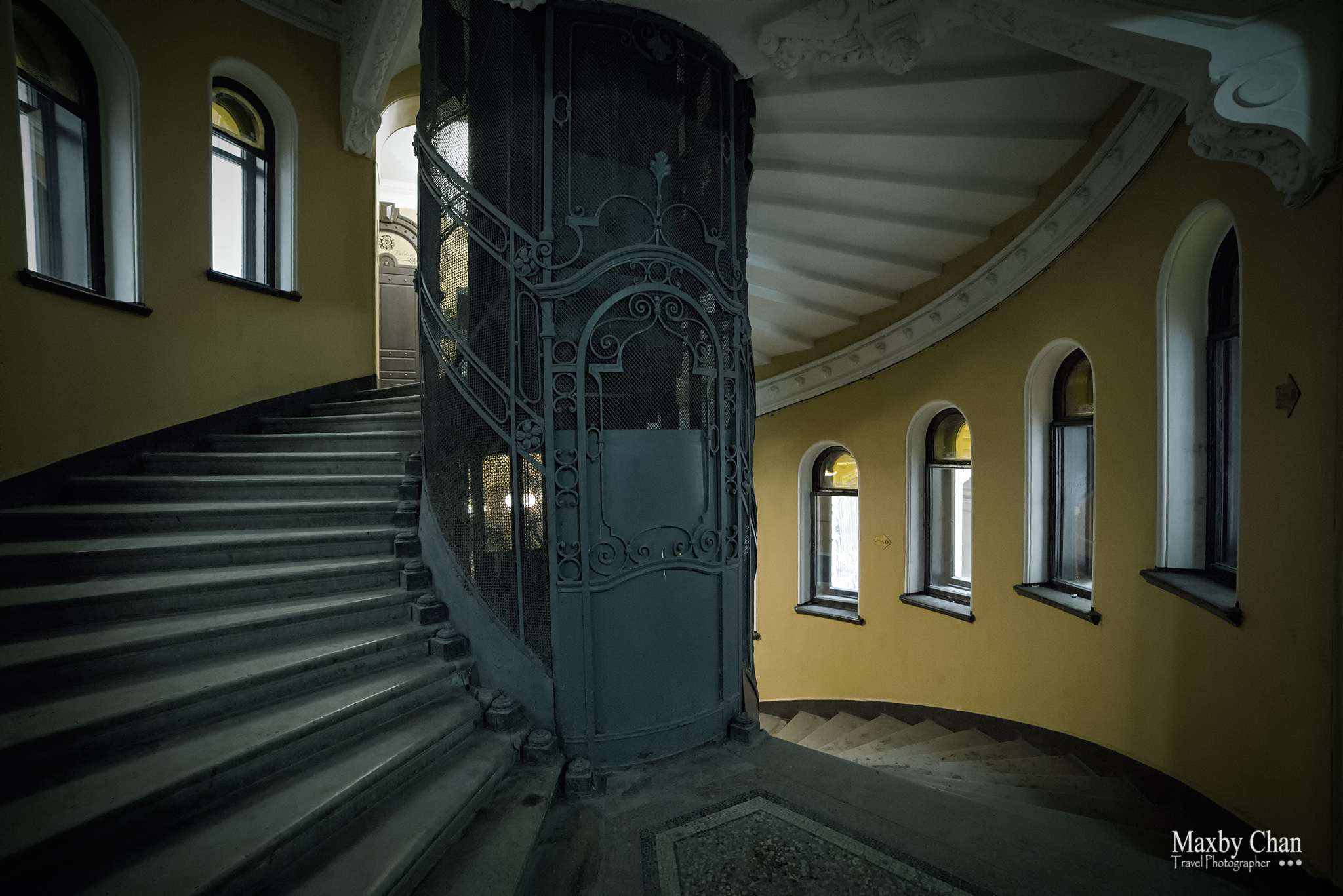 A common spiral staircase with a lift at the central core.