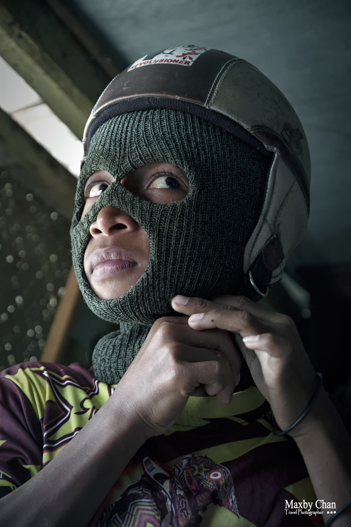 A hood and a helmet is all the protective gear that he is wearing