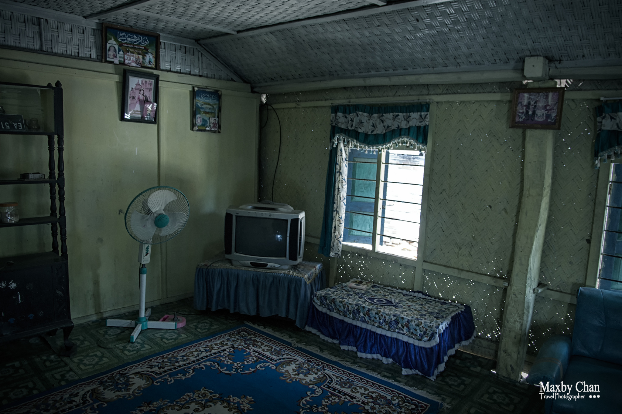 Inside Ayup's home in the village.