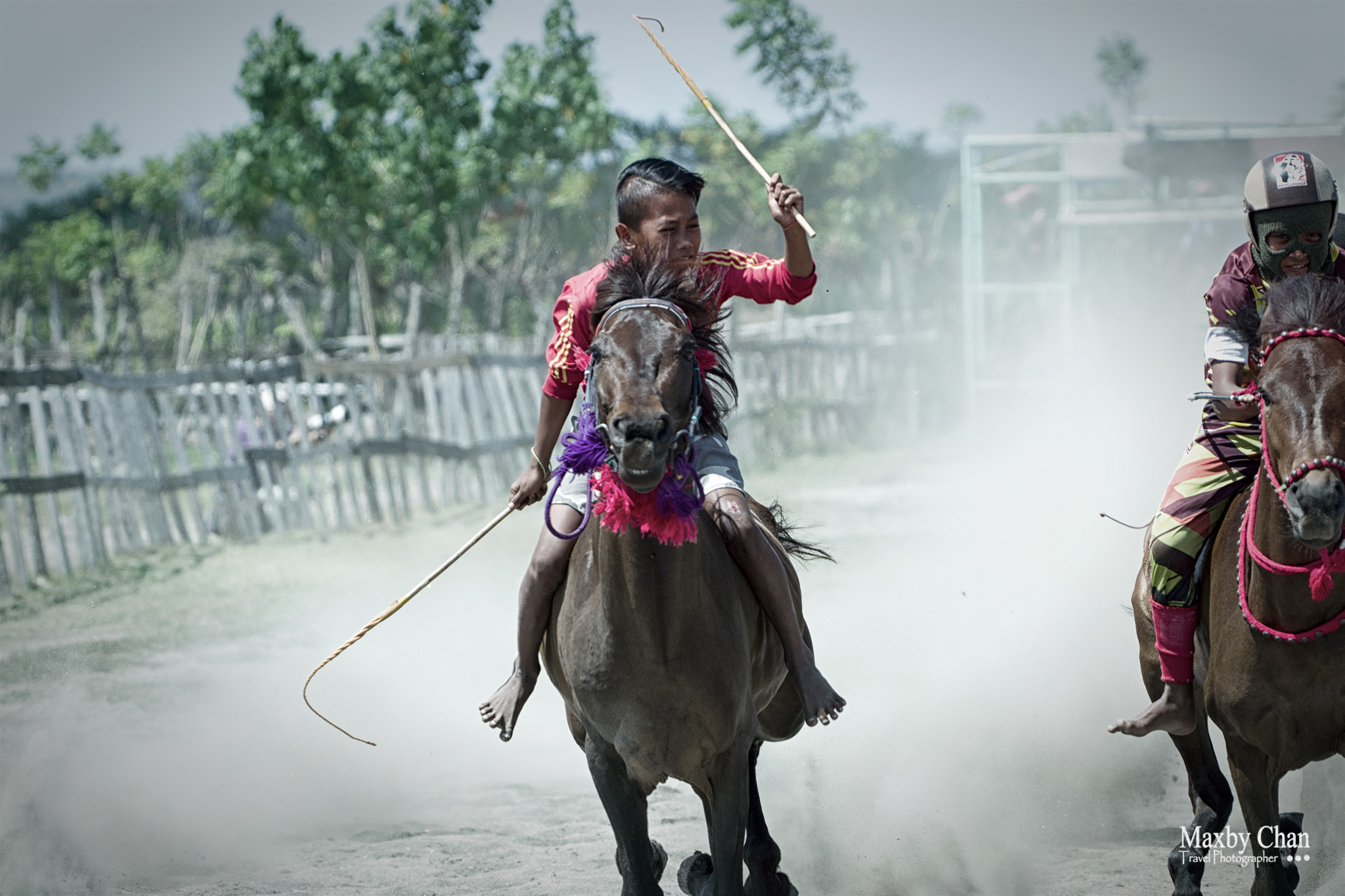 The jockeys were equipped with sticks to encourage their horses to run faster.